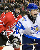 Brayden McNabb (Canada - 3), Iiro Pakarinen (Finland - 10) - Finland defeated Canada 5-4 (so) in the 2009 World Under 18 Championship bronze medal game at the Urban Plains Center in Fargo, North Dakota, on Sunday, April 19, 2009.
