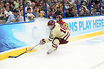 07 APR 2012:  Simon Denis (26) of Ferris State University and Michael Sit (18) of Boston College race for the puck during the Division I Men's Ice Hockey Championship held at the Tampa Bay Times Forum in Tampa, FL.  Boston College defeated Ferris State 4-1 to win the national title.  Matt Marriott/NCAA Photos
