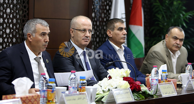"Palestinian Prime Minister, Rami Hamdallah, attends the launch of a book entitled ""The body language in the Israeli media,"" fot the  journalist, Nasser Al-Lahham,  in the West Bank city of Ramallah, on October 17, 2016. Photo by Prime Minister Office"