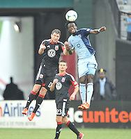 Kei Kamara (23) of Sporting Kansas City heads the ball against Chris Pontius (13) of D.C. United   D.C. United tied The Sporting Kansas City 1-1, at RFK Stadium, Sunday May 19, 2013.