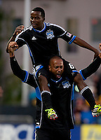 Santa Clara, California - Saturday July 18, 2012: San Jose Earthquakes' Marvin Chavez is hoisted by his teammate Victor Bernardez after his goal during a game against FC Dallas at Buck Shaw Stadium, Stanford, Ca   San Jose Earthquakes defeated FC Dallas 2 - 1.