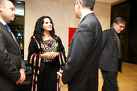 Switzerland. Geneva. World Health Organisation (WHO). Stop TB Partnership. Evening party for a group of national ambassadors against tuberculosis. Rania Ismail, Jordan, actress. Traditional jordanian dress. 5.12.2011 © WHO /Didier Ruef