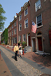 Elfreth's Alley, couple walking past houses, mod rel..Philadelphia, Pennsylvania, PA USA.  Photo copyright Lee Foster, 510-549-2202, lee@fostertravel.com, www.fostertravel.com.  Photo 274-30458