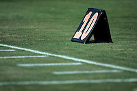 17 May 2005: 10 yard line marker. Football, grass, field, marker, goal line, chalk, stock, closeup, texture, Sports Ball graphic detail, illustration, product, art, clean. Ready for all uses.  Mandatory Credit:  Shelly Castellano