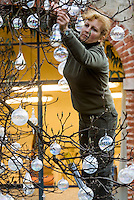 Glass baubles are used to decorate a bare tree in the courtyard