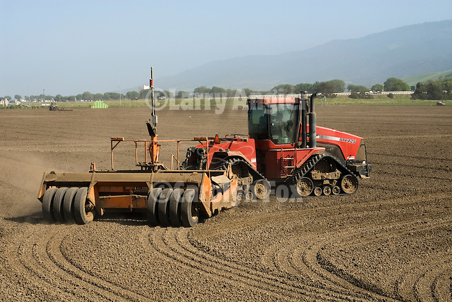 Case IH model STX 425 Quadtrac articulated tractor pulls a laser-controled Miskin scraper-plane though field to flatten it...(tractor based upon the Steiger 4wd design) early 2000s manufacture