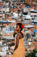 Portrait of beautiful black young woman at Complexo do Alemao, Rio de Janeiro favela. Since 2012 the area has operations of the Pacifying Police Unit ( Unidade de Polícia Pacificadora, also translated as Police Pacification Unit ), abbreviated UPP, a law enforcement and social services program which aims at reclaiming territories, more commonly favelas, controlled by gangs of drug dealers.
