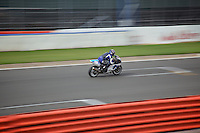 A motorcyclist races at the Silverstone Grand Prix circuit, Northamptonshire