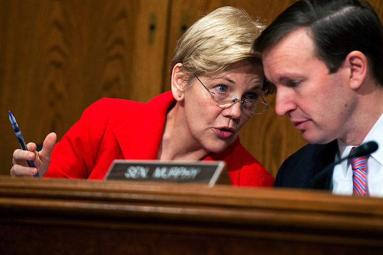 UNITED STATES - APRIL 12: Sens. Elizabeth Warren, D-Mass., and Chris Murphy, D-Conn., attend a Senate Committee on Health, Education, Labor and Pensions hearing in Dirksen Building on the implementation of the Every Student Succeeds Act, featuring testimony by Education Secretary Dr. John King, April 12, 2016. (Photo By Tom Williams/CQ Roll Call)
