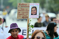 Mexico City, DF May 10, 2014. A woman carries a banner while people takes part of a march demanding the government to search and locate their missing children. During the third National March for Dignity.  Miguel Angel Pantaleon/VIEWpress
