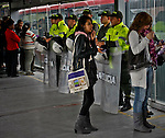 Colombian policemen stand guard in a bus stations after protest for the high cost of unit ticket in Bogota, Colombia. 15/03/2012.  Photo by Nestor Silva / VIEWpress.