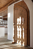 A large wooden door original to the building opens into the kitchen