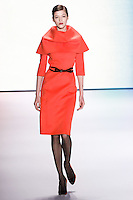 Yulia Kharlaponova walks runway in an outfit from the Carolina Herrera Fall 2011 collection, during Mercedes-Benz Fashion Week Fall 2011.