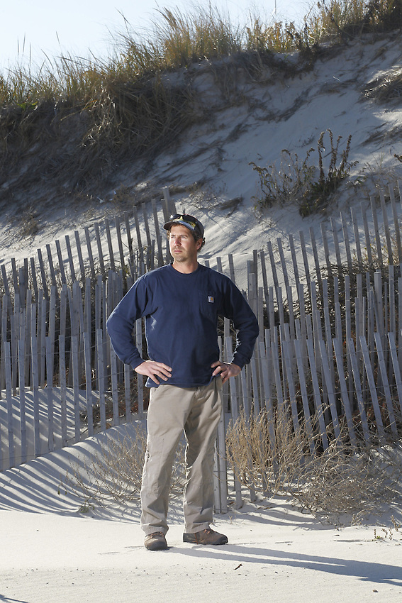 Dominick Solazzo is a board member of the Midway Beach Condo Association in the South Seaside Park section of Berkeley Township. This community of summer bungalows suffered very little damage during Hurricane Sandy, thanks to the huge dunes on the beach here, Solazzo said.  11/29/13 (Andrew Mills/The Star-Ledger)