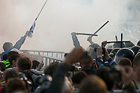 Moscow, Russia, 06/05/2012..Protesters throw objects and use crash barriers in an attempt to break through police lines at  opposition demonstration against Russian Presidential election results on the eve of Vladimir Putins inauguration as President.