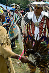 Chief Gail Running Water smudges Timberwolf with sage before he enters the pow wow circle at the Thunderbird Powwow at the Queens County Farm Museum .<br /> <br /> A pow-wow (also powwow or pow wow or pau wau) is a gathering of North America's Native people. The word derives from the Narragansett word powwaw, meaning &quot;spiritual leader&quot;.