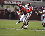 Alabama running back Trent Richardson (3) is chased by Ole Miss safety Johnny Brown (20) at Bryant-Denny Stadium in Tuscaloosa, Ala.  on Saturday, October 16, 2010. Alabama won 23-10.