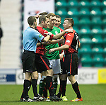 Hibs v St Johnstone....21.12.13    SPFL<br /> Farzer Wright moves Paddy Cregg away from ref Alan Muir after his red card<br /> Picture by Graeme Hart.<br /> Copyright Perthshire Picture Agency<br /> Tel: 01738 623350  Mobile: 07990 594431