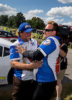 Sept. 2, 2013; Clermont, IN, USA: NHRA pro mod driver Mike Janis celebrates with his crew after winning the US Nationals at Lucas Oil Raceway. Mandatory Credit: Mark J. Rebilas-