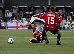Fulham midfielder Kerim Frei (white shirt) is tackled by two Crusaders players during the first half of a UEFA Europa League 2nd qualifying round, fist leg match at Seaview, Belfast. The visitors from England won by 3 goals to 1 before a crowd of 3011.