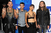 NEW YORK, NY - AUGUST 28:Joe Jonas, JinJoo Lee, Cole Whittle and Jack Lawless of DNCE attend the 2016 MTV Video Music Awards at Madison Square Garden on August 28, 2016 in New York City Credit John Palmer / MediaPunch