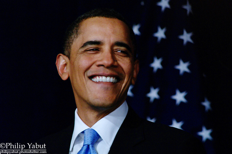President Obama displays his wide grin while delivering a speech at the DNC Winter Meetings on February 4, 2010.