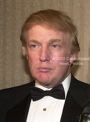 Donald Trump visits the Bloomberg hospitality suite prior to the White House Correspondents Association Dinner at the Washington Hilton Hotel in Washington, DC on April 28, 2001.<br /> Credit: Ron Sachs / CNP