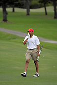 Kailua, Hawaii - December 29, 2008 -- United States President-elect Barack Obama smiles as he motions to a crowd gathered beside the 18th hole to be quiet as they applauded for him but another member of his golfing party was putting in Kailua, Hawaii on Monday, December 29, 2008. Obama and his family arrived in his native Hawaii December 20 for the Christmas holiday..Credit: Joaquin Siopack - Pool via CNP