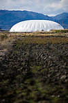 """Photo shows one of the vegetable """"factory"""" domes inside the Minamisoma Agri-Solar Park in Minamisoma, Fukushima, Japan on 10 Feb 2013. More than 2,000 solar panels will power the domes, inside which farmers affected by the 2011 tsunami and nuclear accident will be able to grow produce. Excess power will be sold to a local utilities company. .Photographer: Robert Gilhooly"""