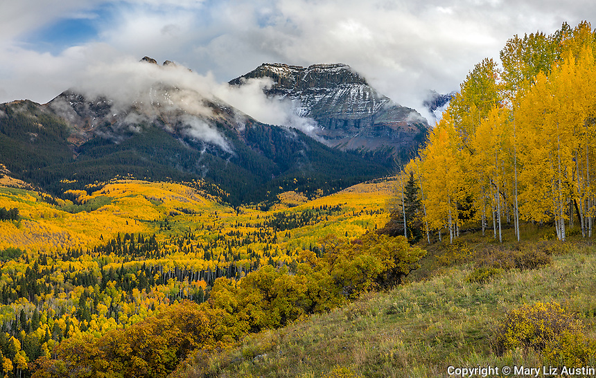 Uncompahgre National Forest, Colorado: Fall colored foothills and clearing clouds over the Sneffels Range.