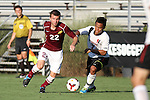 30 August 2013: Elon's Austin Dunker (22) and Northeastern's Nikko Lara (7). The Elon University Phoenix played the Northeastern University Huskies at Koskinen Stadium in Durham, NC in a 2013 NCAA Division I Men's Soccer match. The game ended in a 1-1 tie after two overtimes.