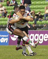 Twickenham, ENGLAND, Bull's, Joe Vagana, carries, Quins, Michael Worrincy, tackle during the 'Engage Super league' match, between Harlequins RL vs Bradford Bulls, at the Stoop, 13.05.2006. © Peter Spurrier/Intersport-images.com,  / Mobile +44 [0] 7973 819 551 / email images@intersport-images.com.