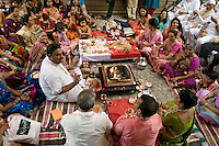 Hindu blessing ceremonies signify the joining of the two families, and bring luck and good fortune to the newlyweds. The priest and women chant and clap together in unison.