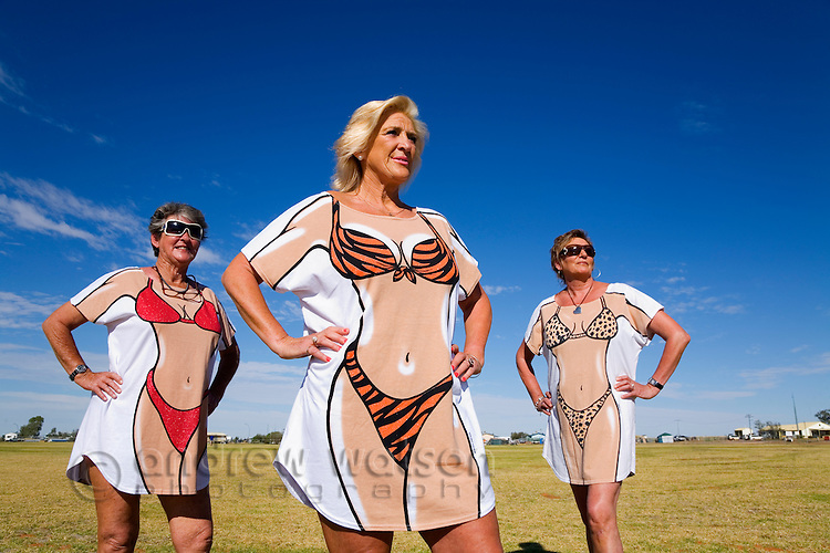 A group of women in novelty dress for the annual Birdsville Races.  Every September thousands arrive in remote Birdsville for the most famous horse racing carnival in outback Australia.  Birdsville, Queensland, AUSTRALIA