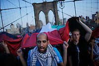 New York City, NY. 20 August 2014.People take part during a Pro-palestine Rally across de Brooklyn Bridge in Manhattan.  Photo by Kena Betancur/VIEWpress