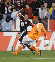 D.C. United midfielder Danny Cruz (2) goes against Houston Dynamo defender Jermaine Taylor (4)  D.C. United defeated The Houston Dynamo 3-2 at RFK Stadium, Saturday April 28, 2012.