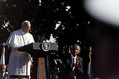 Pope Francis (L) speaks with U.S. President Barack Obama (R) during the arrival ceremony at the White House on September 23, 2015 in Washington, DC. The Pope begins his first trip to the United States at the White House followed by a visit to St. Matthew's Cathedral, and will then hold a Mass on the grounds of the Basilica of the National Shrine of the Immaculate Conception. <br /> Credit: Alex Wong / Pool via CNP