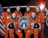 Houston, TX - November 8, 2002 -- These six astronauts take a break from training to pose for the STS-115 crew portrait. Astronauts Brent W. Jett, Jr. (right) and Christopher J. Ferguson, commander and pilot, respectively, flank the mission insignia. The mission specialists are, from left to right, astronauts Heidemarie M. Stefanyshyn-Piper, Joseph R. (Joe) Tanner, Daniel C. Burbank, and Steven G. MacLean, who represents the Canadian Space Agency..Credit: NASA via CNP