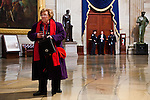 Senator Barbara Mikulski of Maryland checks her phone in the US Capitol Rotunda during the presidential inauguration, January 21, 2013.