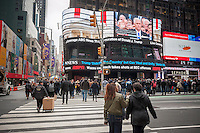 Visitors to Times Square in New York view Mike Pence being sworn in as Vice-President during the inauguration of Donald Trump as the 45th president of the United States, shown on ABC television's giant screen on Friday, January 20, 2017.   (© Richard B. Levine)