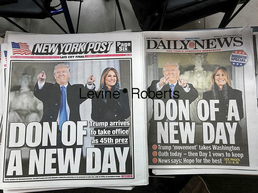 New York tabloid newspapers use similar wire service photographs on their front pages on Friday, January 20, 2017 to report on the upcoming Donald Trump inuguration.   (© Richard B. Levine)