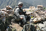 Sgt. 1st Class Jeremiah Smith, 32, of Lewistown, Pa., a soldier with Company A, 2nd Battalion, 503rd Parachute Infantry Regiment, smokes a cigarette after calling in an artillery strike on Taliban fighters in the Narang valley, in Kunar province, Afghanistan. May 17, 2008. DREW BROWN/STARS AND STRIPES