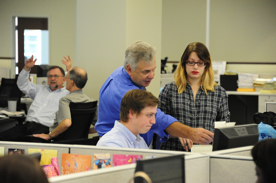 Tim Martin AME News for the Pittsburgh Post-Gazette retires September 25, 2015.<br /> <br /> Martin works with paginators Tyler Pecyna (cq) and Emily Dobler. <br /> <br /> In the background are editors Tom Birdsong, left, who will assume Martin's duties at night, and Tim McDonough, who is transitioning from being editor of the the daily PDF only product, The Pittsburgh Press, which was just discontinued, as part of the relialignment following buy-outs in September, 2015.