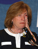 Washington, D.C. - June 29, 2005 --  Mary Fatchett wipes a tear as she speaks at a press conference in Washington, D.C. on June 29, 2005.   Ms. Fatchett, a member of the Coalition of 9/11 Families, is in Washington to lobby against the International Freedom Center (IFC).<br /> Credit: Ron Sachs / CNP