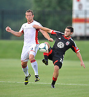 Daniel Woolard (21) of D.C. United goes against Chad Barret (9) of the New England Revolution. D.C. United defeated the The New England Revolution 3-1 in the Quarterfinals of Lamar Hunt U.S. Open Cup, at the Maryland SoccerPlex, Tuesday June 26 , 2013.