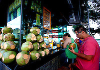 A gentleman enjoys a 'Agua de coco' (Coconut water) on Boa Viagem beach in Recife, Brazil, one of the 12 host cities of the 2014 FIFA World Cup