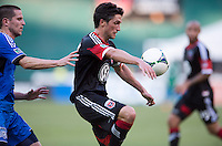 John Thorrington (8) of D.C. United keeps control of the ball in front of Sam Cronin (4) of the San Jose Earthquakes during a Major League Soccer game at RFK Stadium in Washington, DC.  D.C. United defeated San Jose Earthquakes, 1-0.