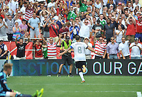Clint Dempsey (8) of the USMNT celebrates his first goal of the game. The USMNT defeated Germany 4-3, during and international friendly commemorating the centennial celebration for U.S. Soccer, at RFK Stadium, Sunday July 2 , 2013.