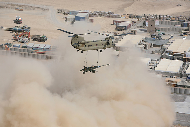 A CH-47 helicopter airlifts a 155mm howitzer to a new NATO base near the border town of Spin Boldak in Kandahar province, Afghanistan. July 31, 2009. DREW BROWN/STARS AND STRIPES