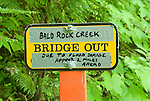 Improvised trail sign warning of bridge-out from flood damage in Mount Rainier National Park, Washington State.